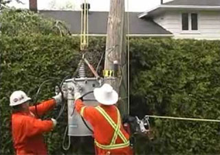 Winch lifting a transformer